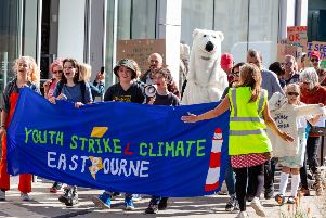Tilia Guilbaud-Walter, far left, and protesters in Eastbourne as part of the Global Climate Strike  Credit: SEUK News/Alamy Live News. (Photo by Pete Abel)
