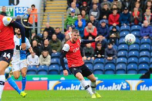 Ryan Tunnicliffe sends a pass out wide at Blackburn on Saturday