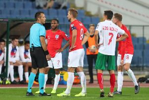 England captain Harry Kane speaks to the referee during one of the stoppages in Tuesday's game with Bulgaria. Picture: Getty.