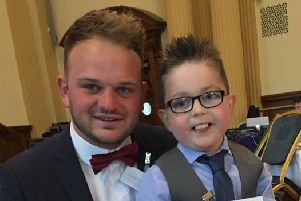 Ballymena boy Mark Lynn, aged 8, who lost his battle this week with congential heart disease. He is pictured with his brother Geoff at the British Heart Foundation's Heart Hero Awards in Belfast City Hall last year where he was named the Young Heart Hero.
