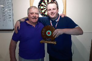 Ryan Tapp won the Friday Night Charity Darts Leagues Tony Grimmett Trophy for the second year running and was presented with his trophy by Bill Grimmett