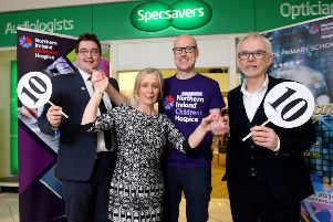 Heather Lewis gets into training for 'Sunnylands does Strictly' with Johnny Breen, Children's Hospice regional fundraiser and receives top marks from Tony McGinn (right), Specsavers optometry director and Darryl Marshall, store manager.