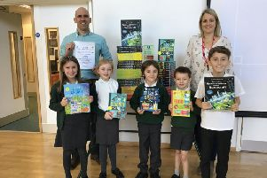 Some of the pupils with their new books