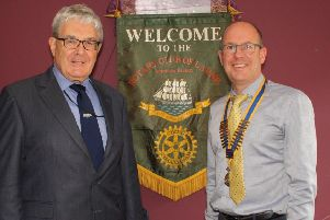 President Michael Thompson welcomes Charles Friel of the Railway Preservation Society of Ireland to the Rotary Club of Larne.