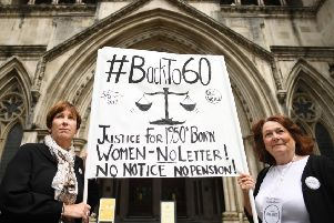 Anne Taylor (left) and Patsy Franklin from the campaign 'Back to 60' outside the Royal Courts of Justice in central London, ahead of the first day of a landmark legal case against the Government brought by women affected by the state pension age increase. Pic: Stefan Rousseau/PA Wire