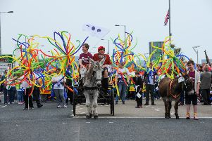 The first Learning Disability Pride parade making its way along Carrick's Marine Highway.