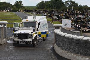 Police at the scene of a security alert at a  Lurgan cemetery on Monday. I't is understood the Army bomb disposal team has been called to St Coleman's graveyard in Lurgan, Co Armagh.'Photo: Colm Lenaghan/Pacemaker