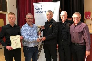 Gregory Lutton, Kellswater Band, receives the Best Grade 2 Band award from Stephen Bailie at the recent Flute Band Association Contest.