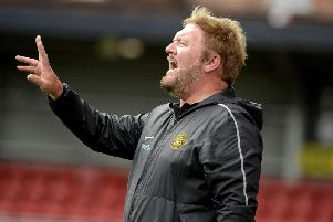Niall Currie, Carrick Rangers manager.
