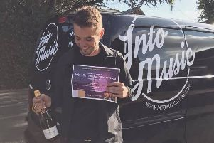 Jake Harris with his lucky bottle of champagne.