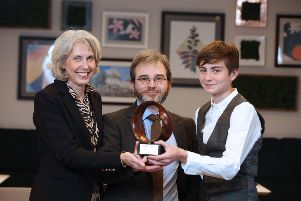 Dr Mark McCartney with his wife Karen and younger son Peter after receiving the Maths Week Ireland 2019 award for Raising Public Awareness of Maths.