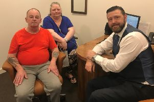 Thomas and Rhona with audiologist Patrick (right).