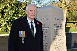 David McNeill compiled the names of fallen soldiers in World War 1 for the new stone clad pillars at Larne war memorial. INLT 42-002-PSB
