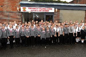 The combined choirs of St John The Baptist Primary School and Edenderry Primary School who entertained guests at the opening of Portadown Wellness Centre. INPT46-200.