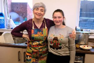 Gillian McKee and Emily Boomer make sure everyone enjoys the Whitehead community Christmas Day dinner in the Methodist Church Hall.