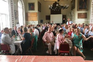 Guests, including MP Nick Herbert, front centre, and organiser Andy Batty, rear standing, at Arundel Town Hall enjoying the Feast of St George