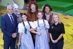 From L to R: Jonathan Martindale, Executive Director, Phoenix Natural Gas, Conall McGinn as Tin Man, Holly Topping as Dorothy, Alex Jemphrey as Cowardly Lion, Caroline McMichael as Dorothy, Peter Gildernew as Scarecrow and �ine Dolan, Creative Learning Manager and Associate Producer of the Grand Opera House Youth Production.