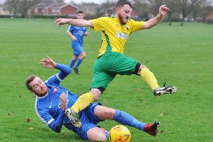 Action from Crowland's 6-0 win over Whittlesey Athletic Reserves (blue). Photo: David Lowndes.
