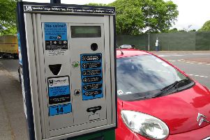 A car parked next to a parking meter