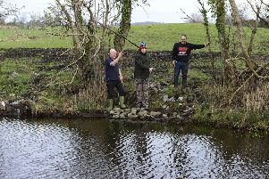 News Letter's Graeme Cousins (centre) joins Nigel Cree (left) and Robert Maxwell (right) at the location of the planned fishing retreat. 'Picture by Arthur Allison Pacemaker