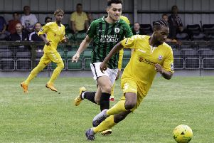 Potters Bar, in yellow, in action at Burgess Hill earlier in the season / Picture by Chris Neal