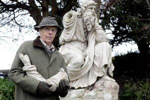 Chichester resident David Hide, standing in front of the Coade stone statue in Priory Park. Calls have been made to speed up plans for its restoration