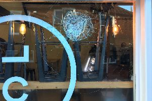 Damage to the window of Coffee Lab in Cathedral Courtyard
