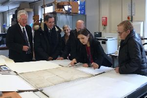 A tour of West Sussex Records Office, viewing the rare Sussex copy of the American Declaration of Independence. Picture courtesy of West Sussex County Council