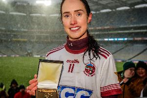 Slaughtneil's Tina Hannon receives the Player of the match award after Sunday's AIB All-Ireland Senior Camogie Club Championship Final in Croke Park.