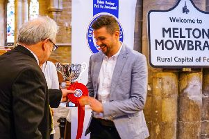 Phil Turner collects trophy for award-winning pie at British Pie Awards