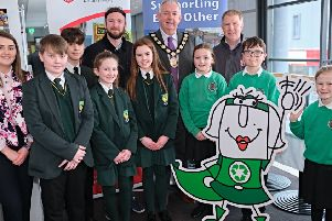 Chair of Mid Ulster District Council Sean McPeake launches the Irish language recycling guide with students from Gaelscoil Eoghain and Scoil I�saef