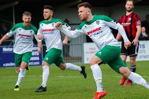 Theo Widdrington takes the plaudits after pulling Bognor level from the spot / Picture by Tommy McMillan