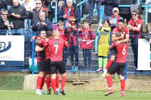 The Poppies players celebrate their winning goal at Halesowen. Picture by Peter Short
