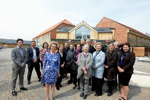 The senior management, trustees and the transition project team outside the new Hospice
