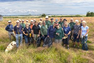 A Friends of Chichester Harbour working party carrying out litter picking and enjoying the glorious views they wish to protect. Picture (C): Paul Adams