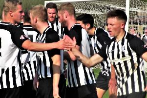 The Corby Town players celebrate one of their goals during the 3-2 success over Yaxley on Easter Monday. Picture by David Tilley