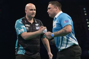 Rob Cross (left) shakes hands with Gerwyn Price after their 7-7 draw. Picture courtesy Lawrence Lustig/PDC