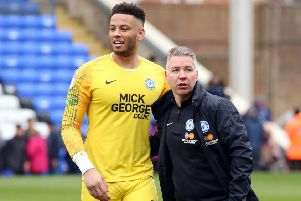 Posh goalkeeper Aaron Chapman with manager Darren Ferguson.