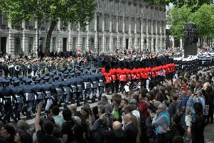 Veterans and serving military march down Whitehall past The Cenotaph during the VE Day Anniversary parade on May 10, 2015 in London  (Photo by Stuart C. Wilson/Getty Images)