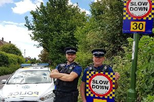 Police with the new signs in Bosham. Photo: Chichester Police/Twitter
