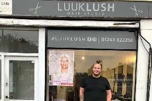 Luke proud outside his new studio