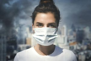 Wearing a face mask offers some protection from toxic air iStock/PA
