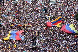 A mass protest against the Venezuelan government this February following years of shortages and rising poverty; SF MPs took Venezuelan-funded trips in 2017/2018 worth about �2,300, and were described as election observers