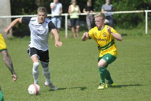 Jack Shonk on the ball for Bexhill United against Hailsham Town on Easter Monday. Picture by Simon Newstead