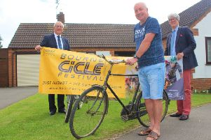 John Baldwin and his father's bike, with (left) Paul Stokes, SKDC corporate operations lead and (right) Andrew Norman, Head of Visitor Economy for InvestSK. EMN-190907-164436001