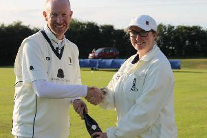 Caistor's Sean Woolley receives the man-of-the-match award from umpire Beth Smith EMN-190715-154510002