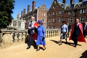 The Queen and Prince Philip at St John's College, at the University of Cambridge. Institutions such as the monarchy, universities and BBC are still the envy of much of the world, says John Kyle. Photo: Chris Radburn/PA Wire