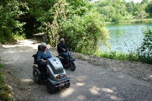 Val Rawlings and Bob McLellan, from The Disabled Ramblers, try out the new path