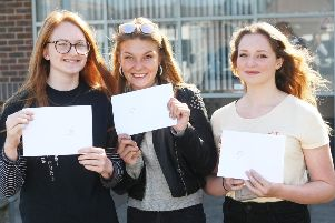 DM1982476a.jpg. A' level results 2019. Felpham Community College. From left Anna Withers, Diana Buta and Alice Whiston. Photo by Derek Martin Photography. SUS-190815-130620008