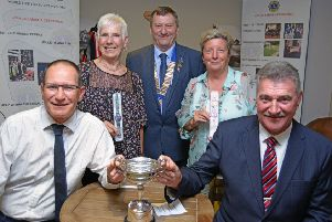 Overall winners Keith Tomblin (left) and Bill Hurrell (right), with ladies' winners Bettyne Norton (second left) and Davina Hughes, with Lion president Geoff Tate. Picture: Whitehouse Photography EMN-190820-131222002